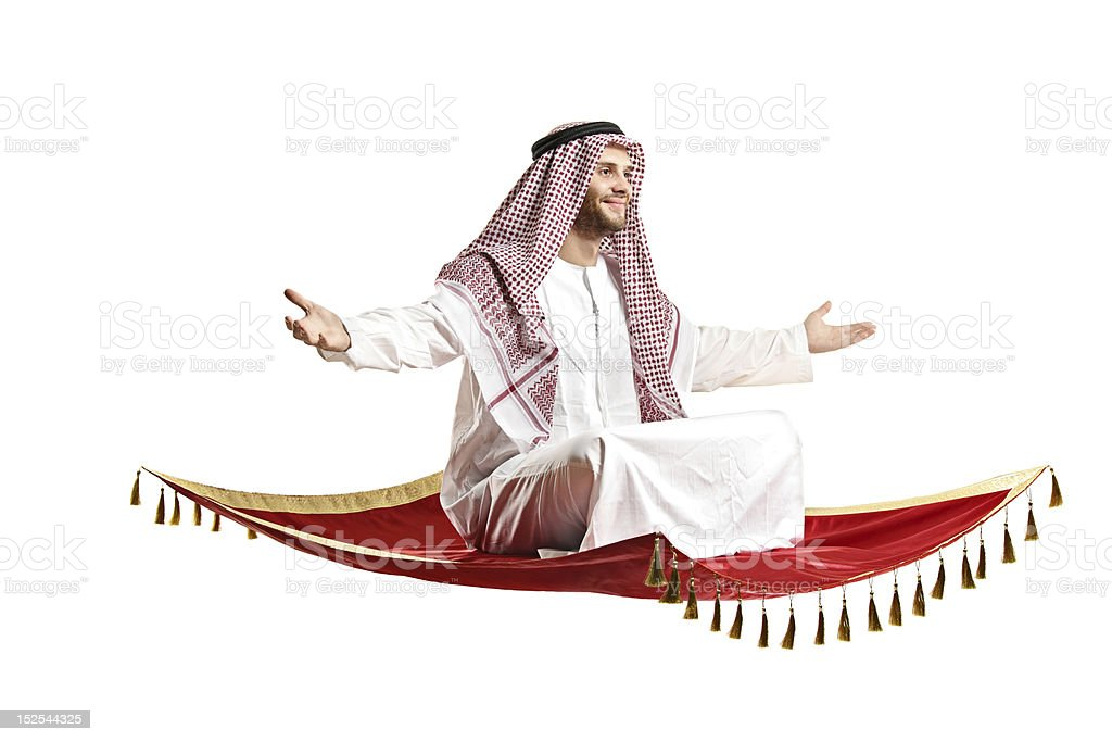 Arab person sitting on a flying carpet stock photo