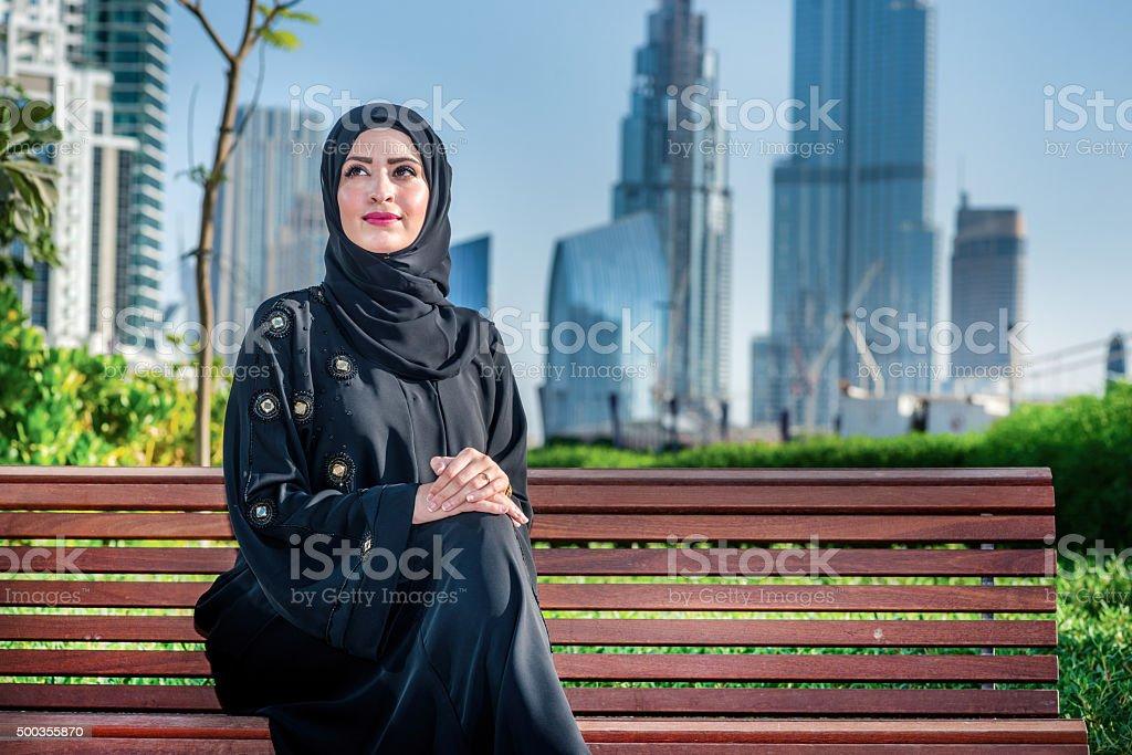 Arab success. Arab businesswomen in hijab sitting on bench stock photo