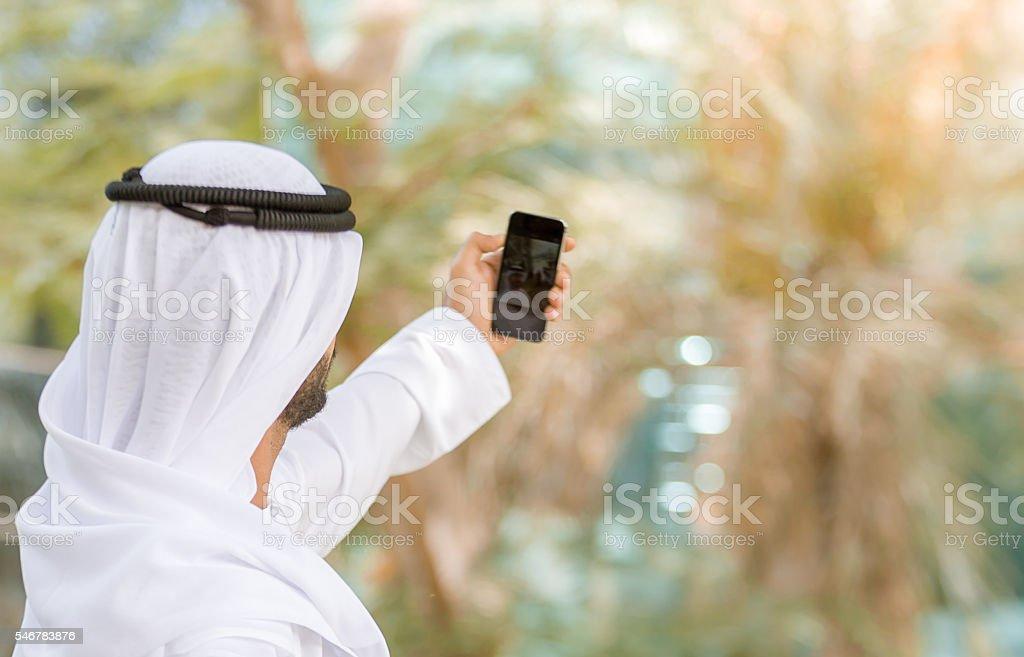 Arab taking a selfie stock photo