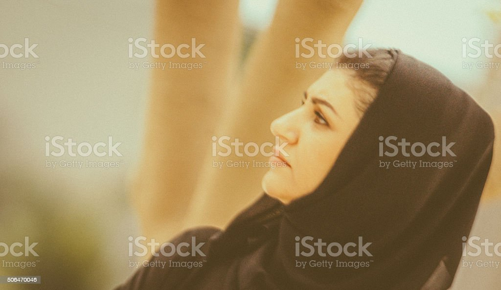 Arab Woman in a park stock photo