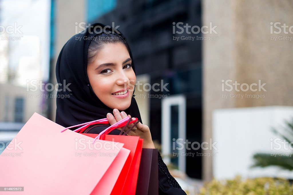 Arab woman shopping stock photo