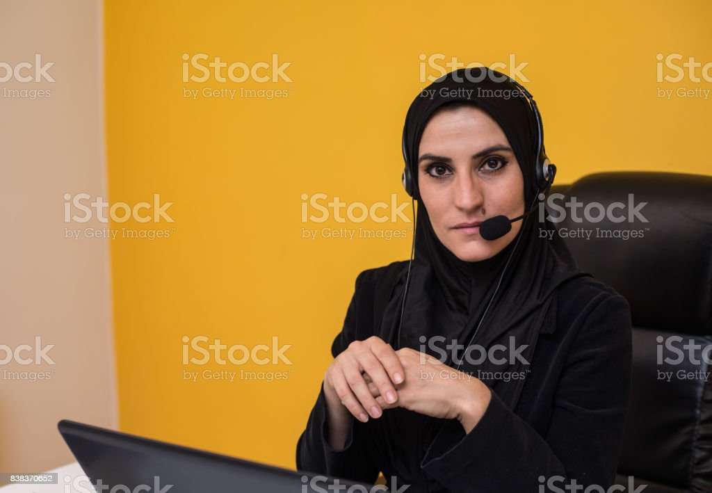 Arab Woman Working At Home Using  Laptop. stock photo