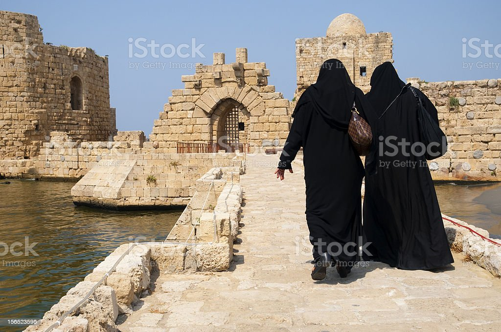 Arab women at Sea Castle in Sidon, Lebanon stock photo
