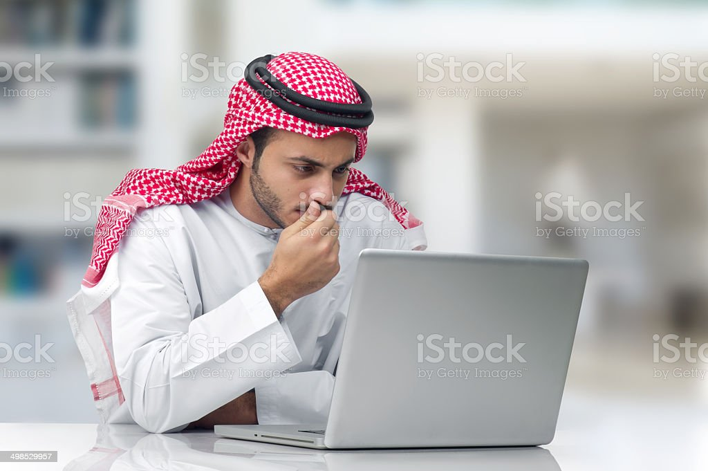 Arabian businessman working in his office royalty-free stock photo