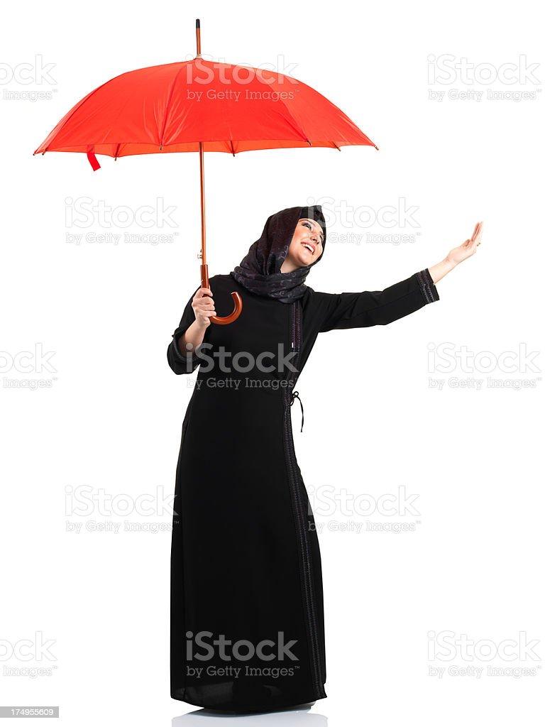 Arabian Businesswoman and Red Umbrella royalty-free stock photo