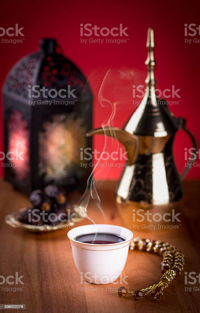 Arabian Coffee with dates and Ramadan lantern. stock photo