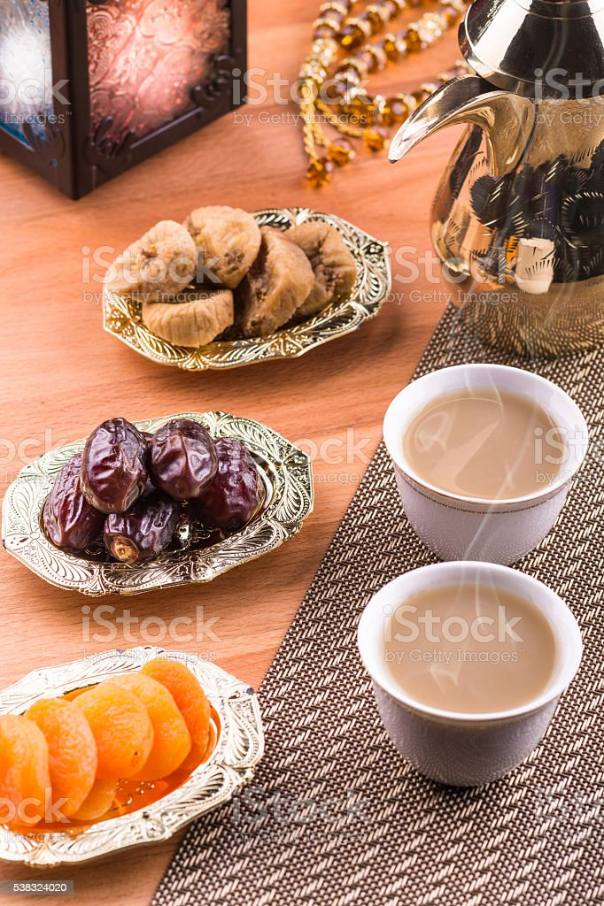 Arabian coffee with dried fruits stock photo