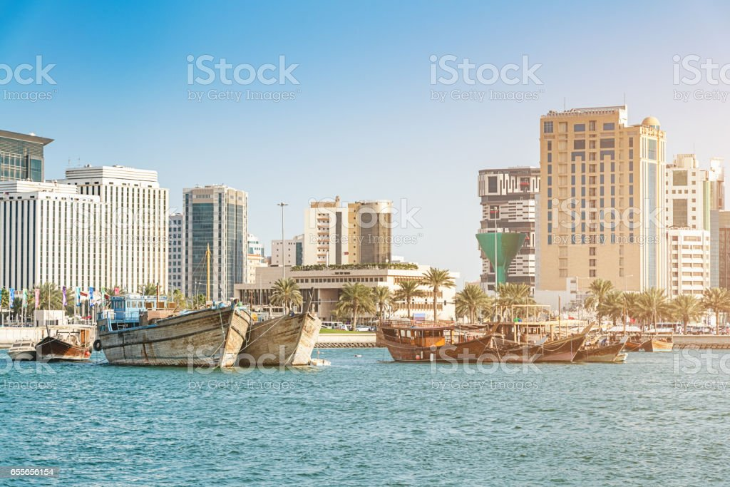 Arabian Dhows Boats in front of Doha Cityscape Qatar stock photo