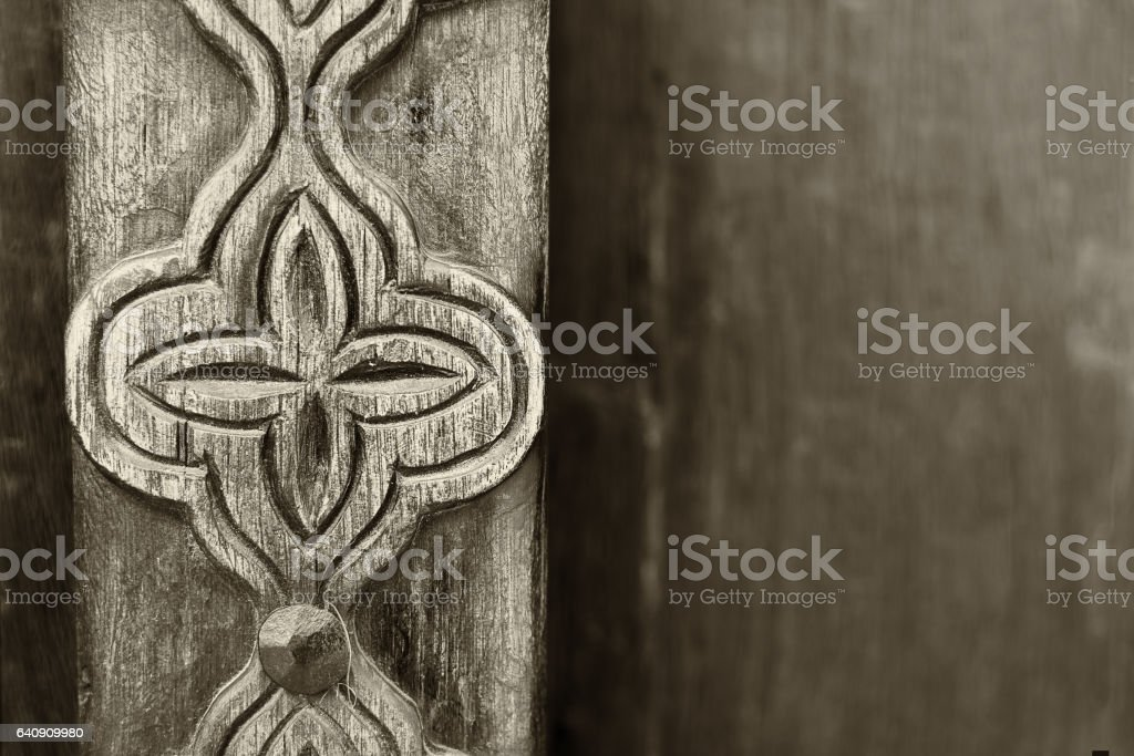 Arabian door detail with stylised flower carving stock photo