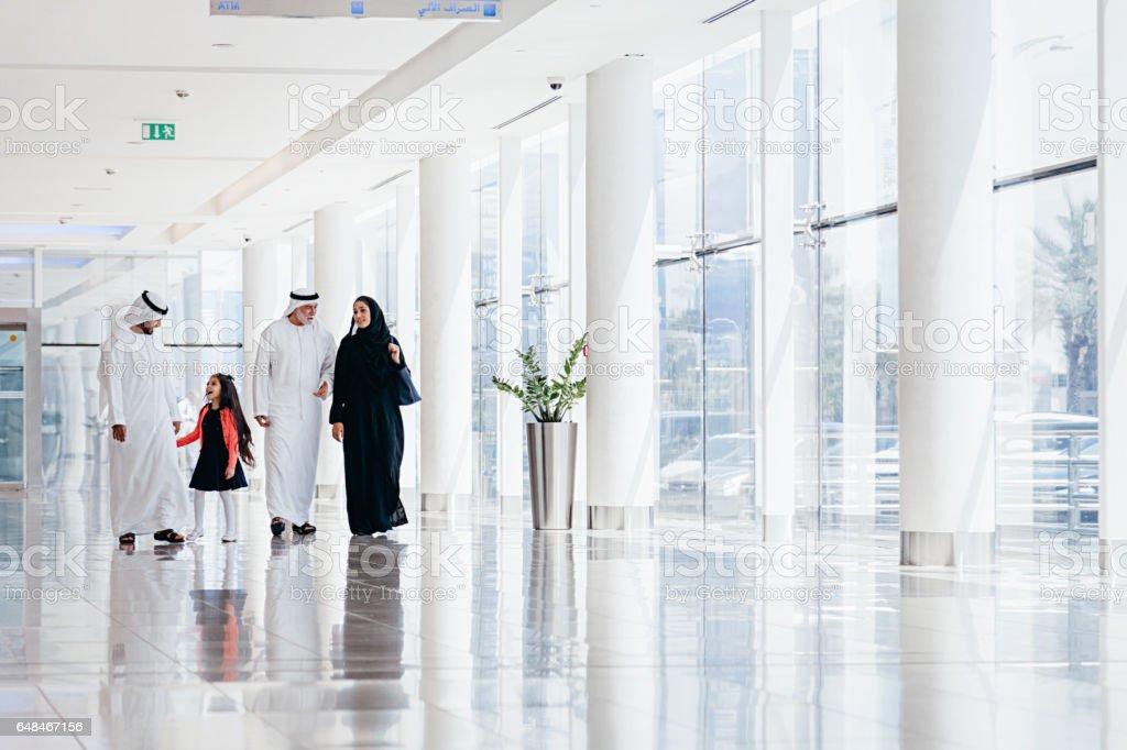 Arabian family at shopping mall stock photo