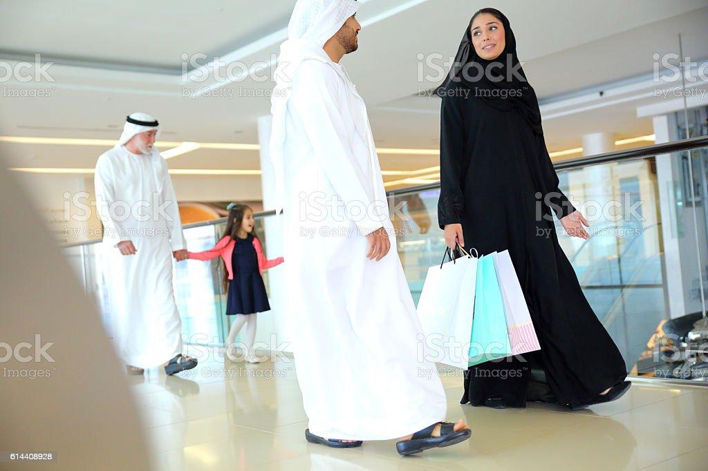 Arabian family in shopping mall stock photo
