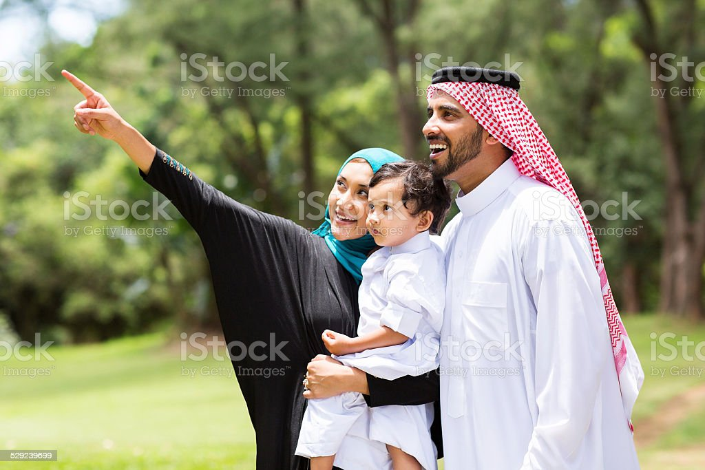 arabian family in the forest stock photo