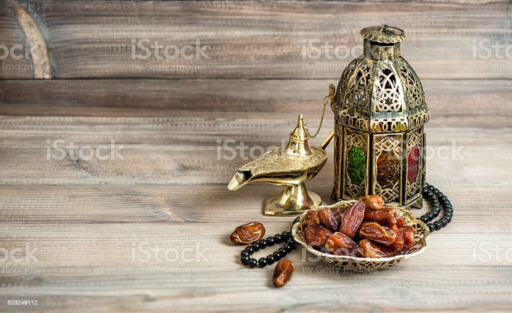 Arabian lantern, dates  rosary. Islamic holidays concept stock photo