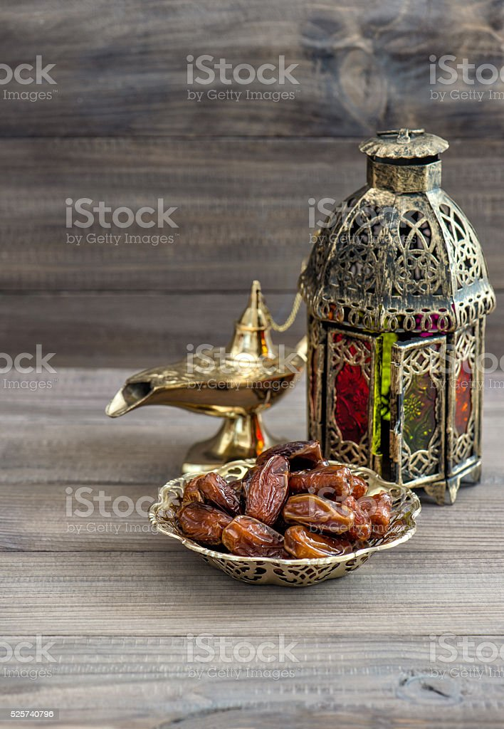 Arabian lantern, golden lamp, fruits. Ramadan kareem stock photo