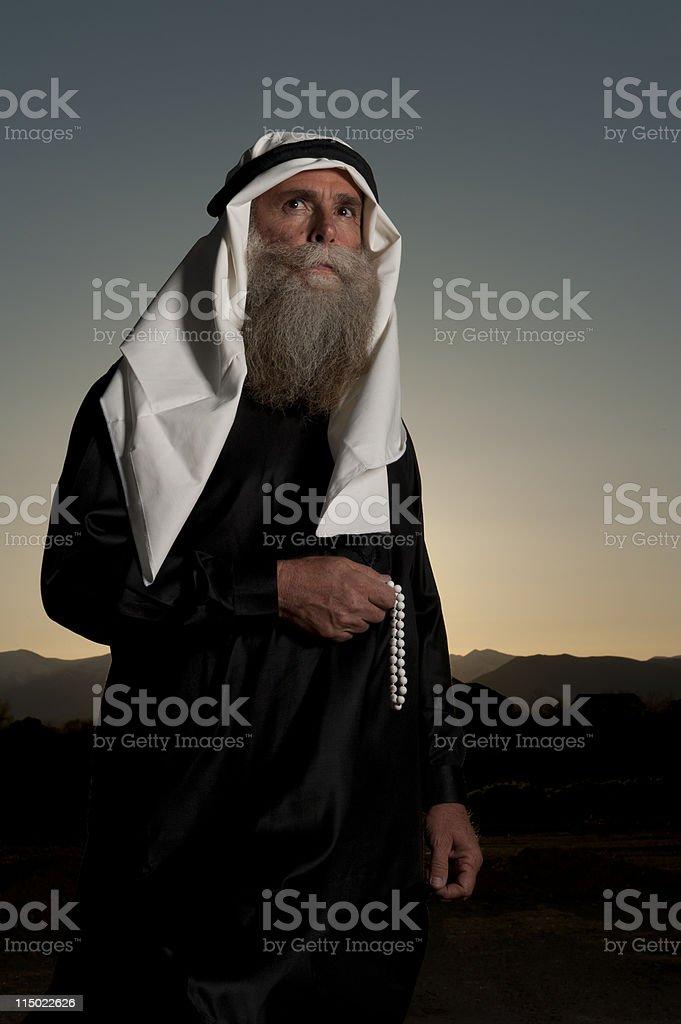 Arabian man carrying prayer beads royalty-free stock photo