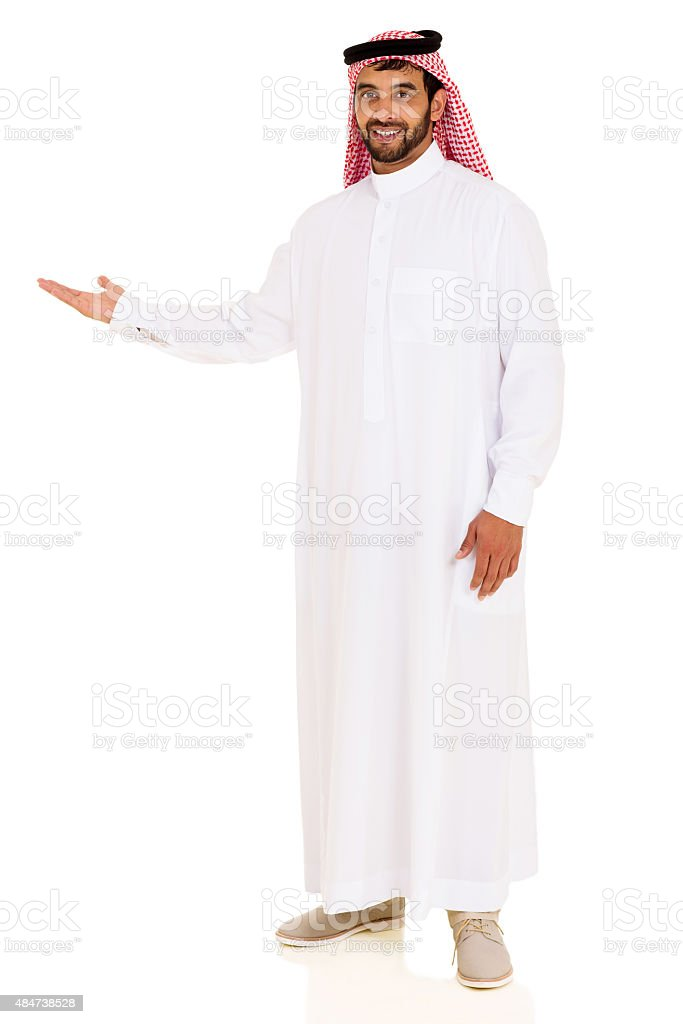 arabian man showing empty space stock photo