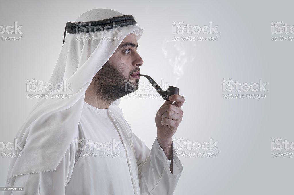 Arabian Man smoking Pipe stock photo