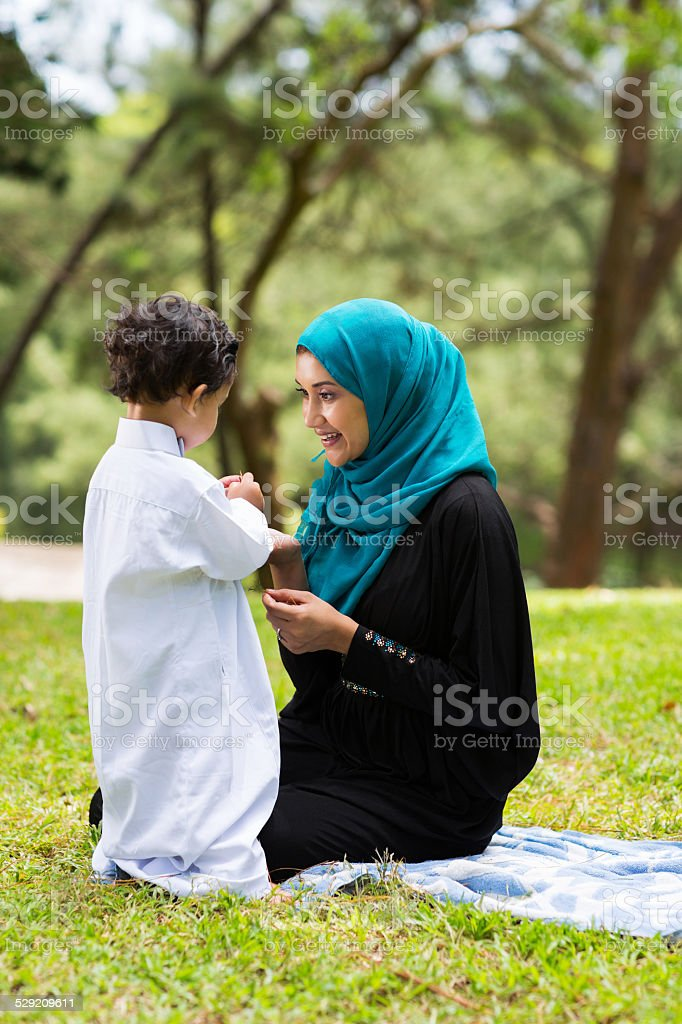 arabian mother playing with her baby boy stock photo