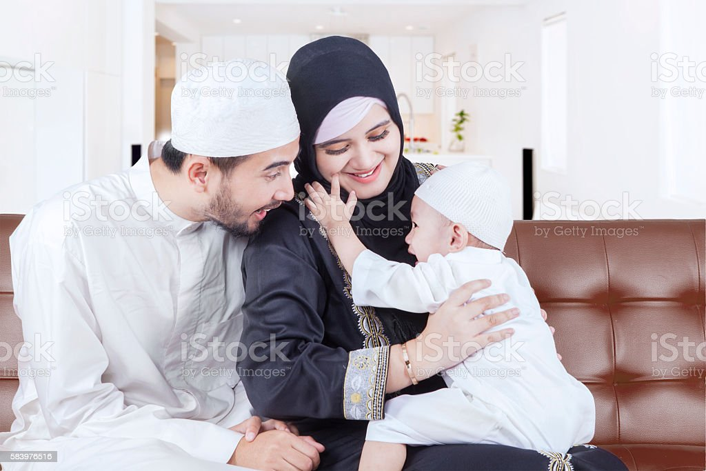 Arabian parents joking with their son stock photo