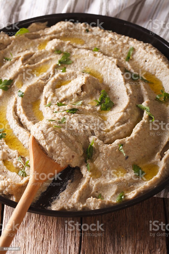 Arabic appetizer: baba ghanoush closeup in a plate. vertical stock photo