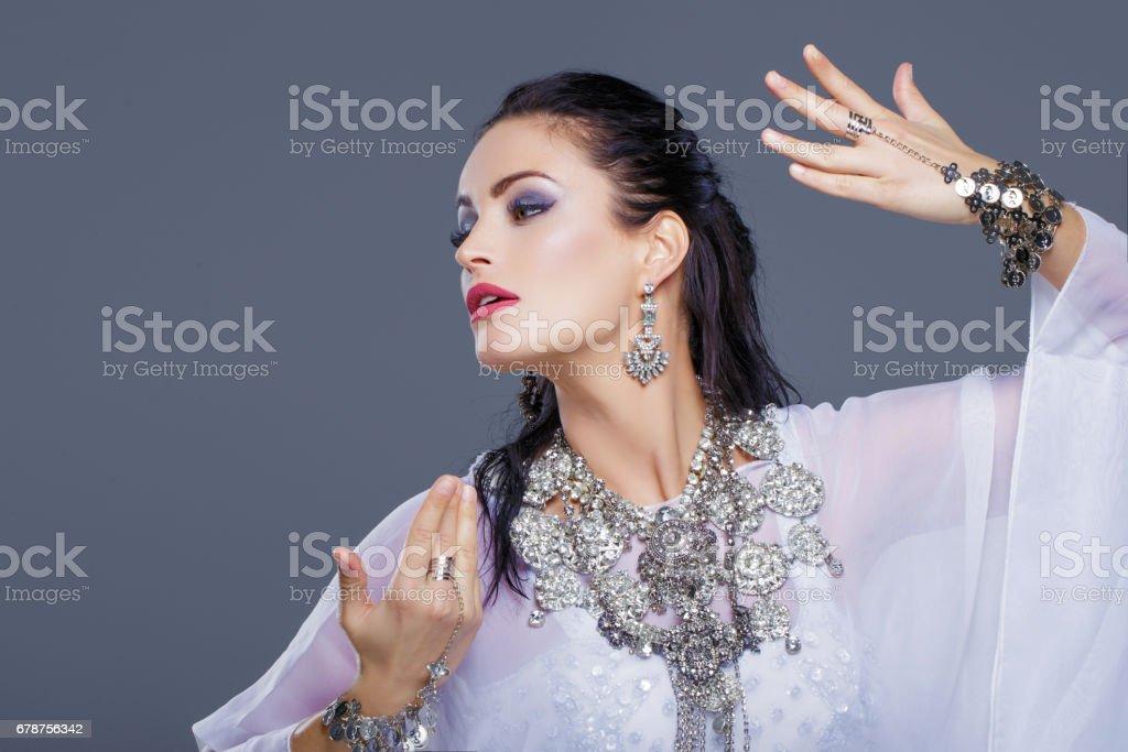 Arabic belly dancer dancing portrait stock photo