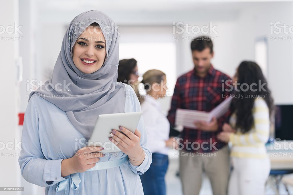 Arabic business woman working in team stock photo