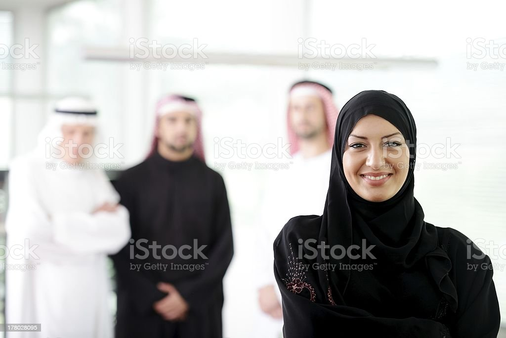 Arabic business woman working in team with her colleagues royalty-free stock photo