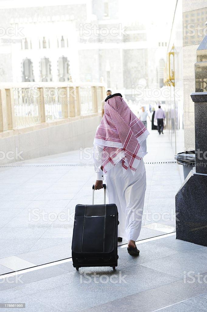 Arabic businessman walking royalty-free stock photo