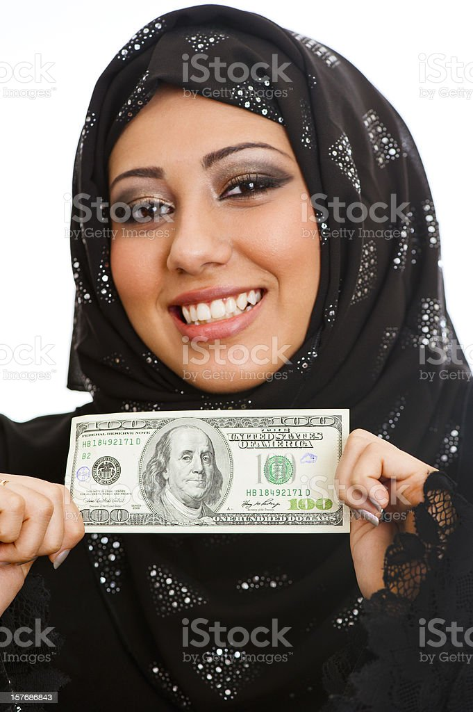 Arabic businesswoman holding 100 dollar royalty-free stock photo