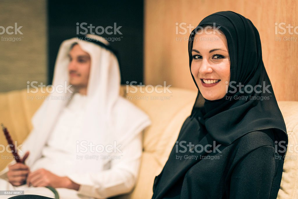 arabic couple at home stock photo