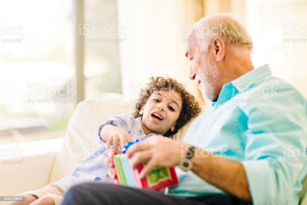 Arabic family birthday exchanging gifts stock photo