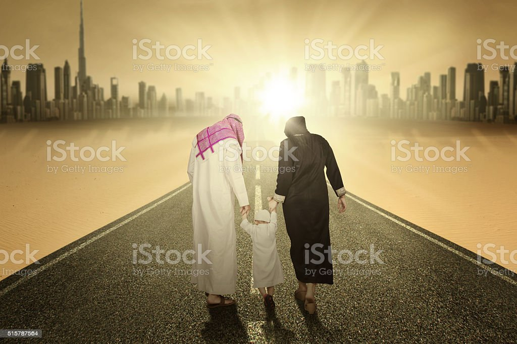 Arabic family walking on the highway stock photo