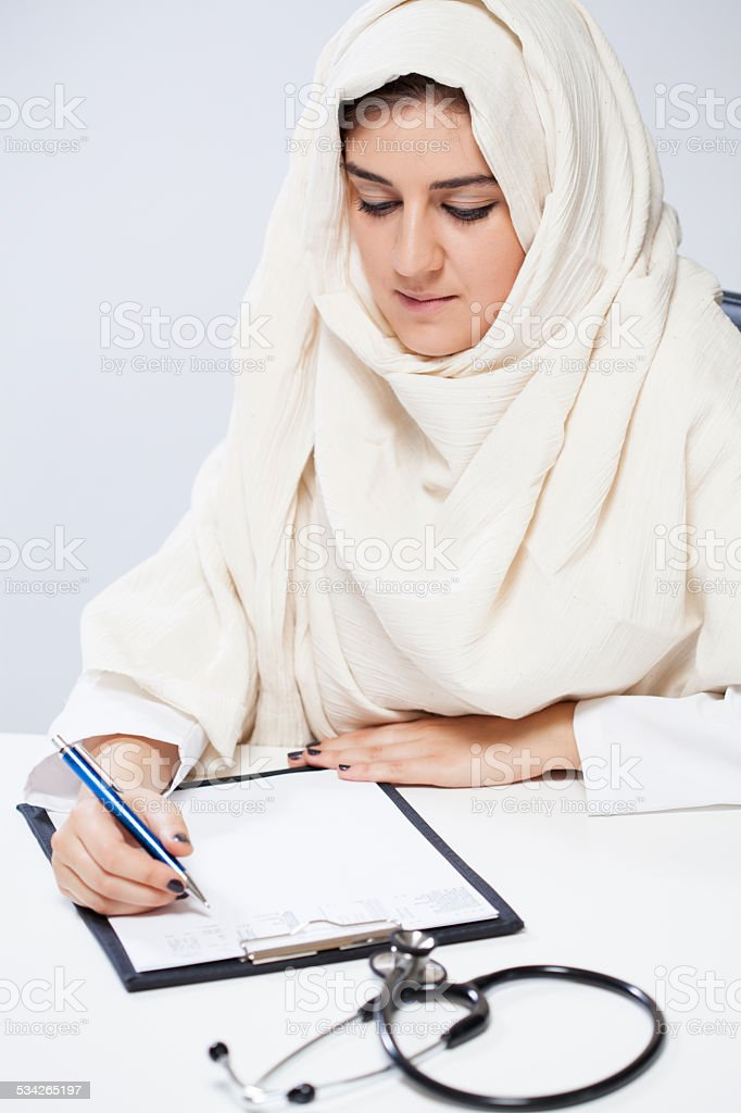 Arabic female doctor during work stock photo