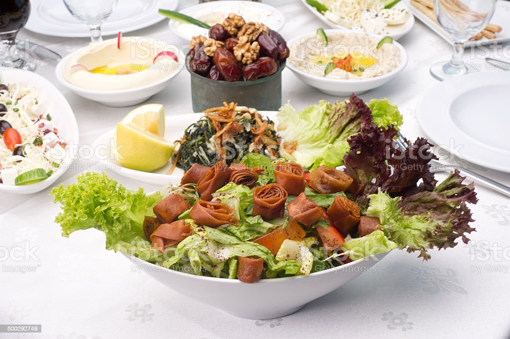 Arabic food of fattoush , hommos cheese , dates served during Ramadan stock photo