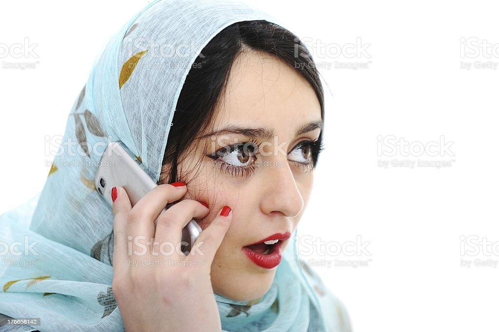 Arabic girl talking on cell phone royalty-free stock photo