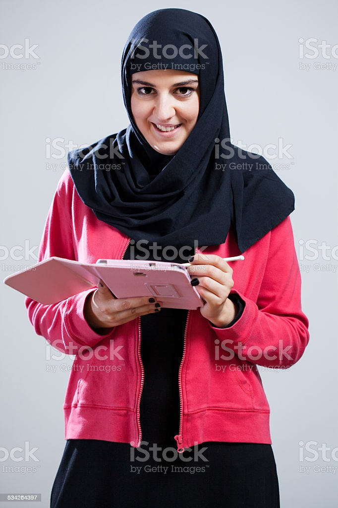 Arabic girl with a tablet stock photo