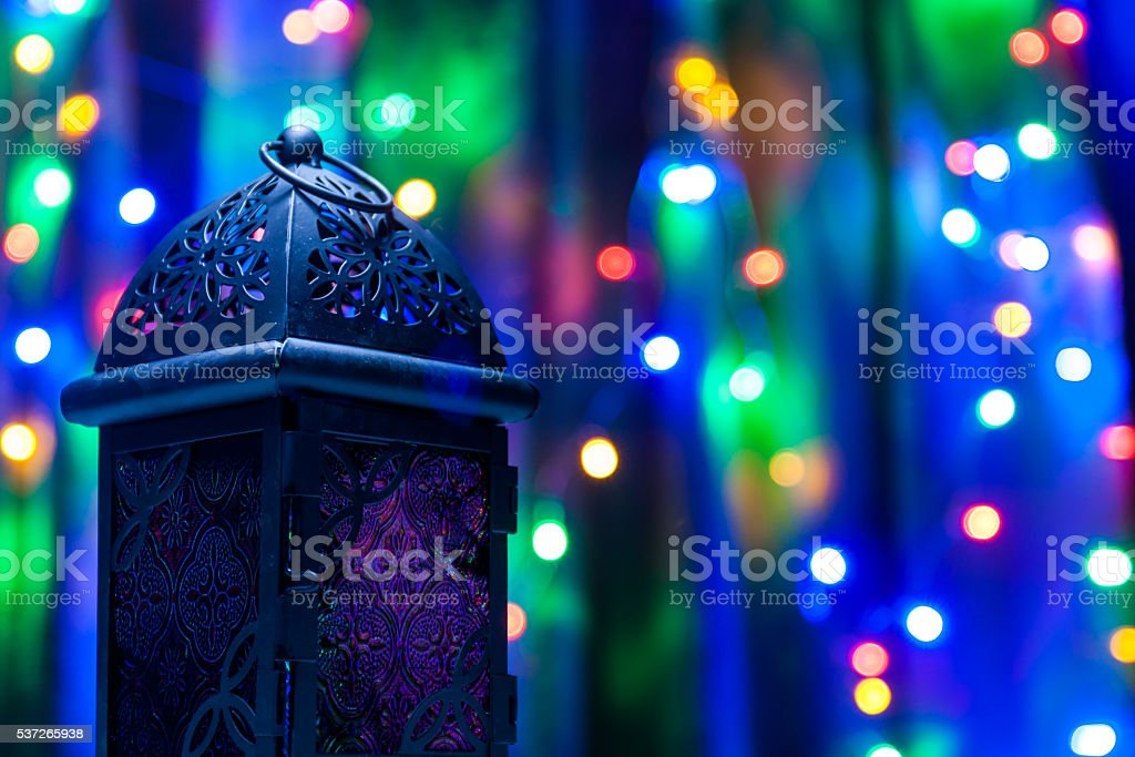 Arabic lantern on colorful light background. stock photo