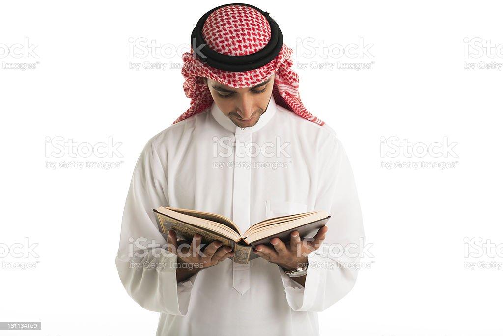 Arabic man reading the holy Koran royalty-free stock photo