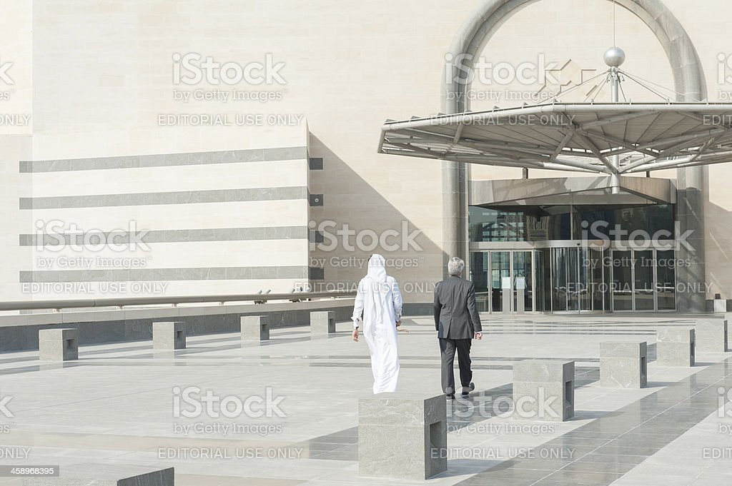 arabic men at the museum of Islamic Art in Doha royalty-free stock photo