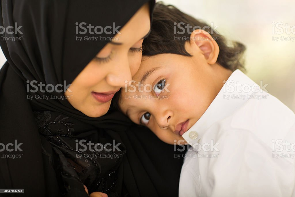 Arabic mother and little boy stock photo