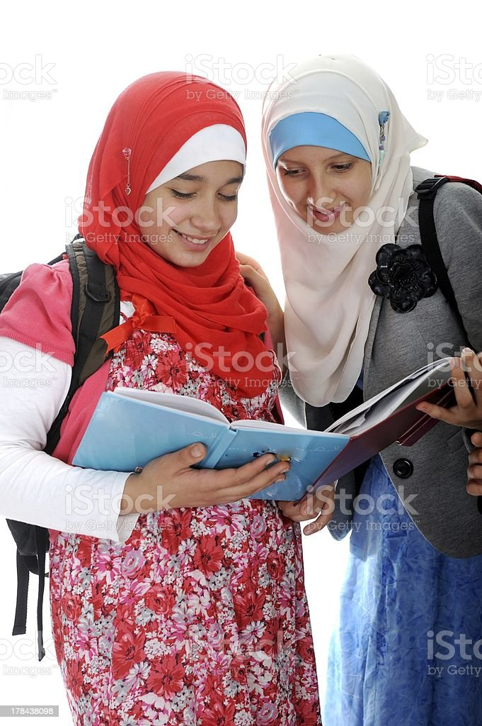 Arabic Muslim girls wearing Islamic clothes royalty-free stock photo