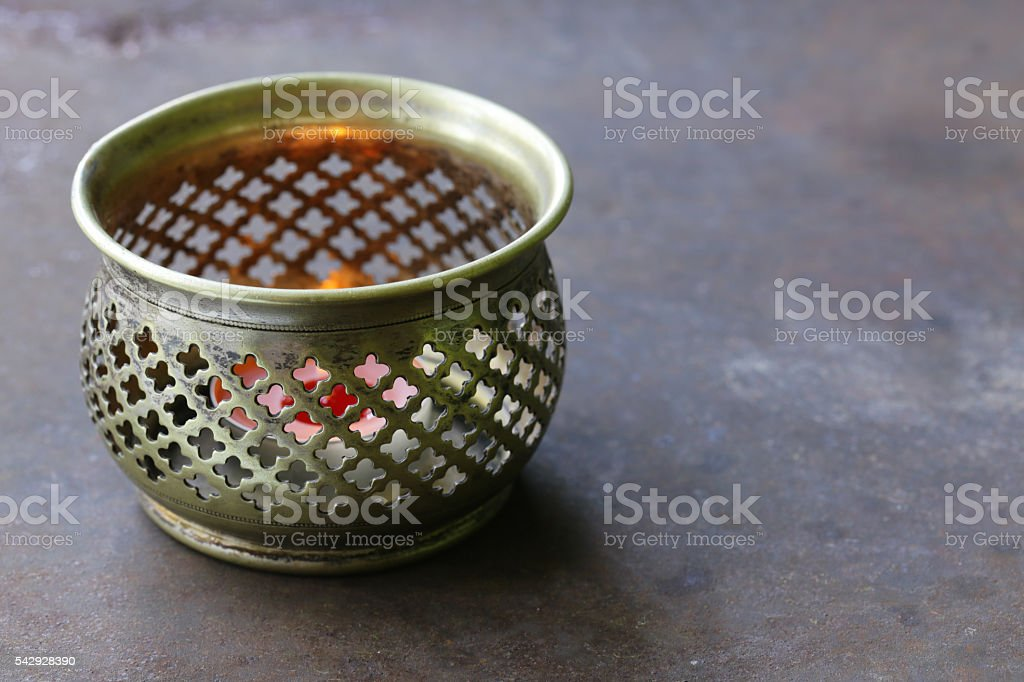 Arabic silver vintage lantern on an old iron background stock photo