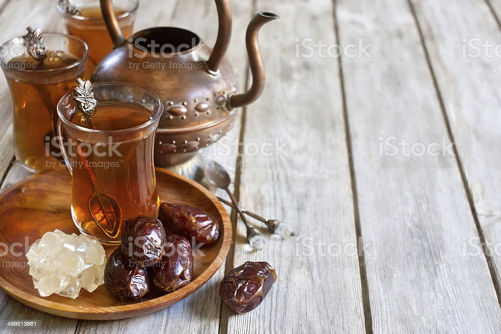 Arabic tea and dates background stock photo