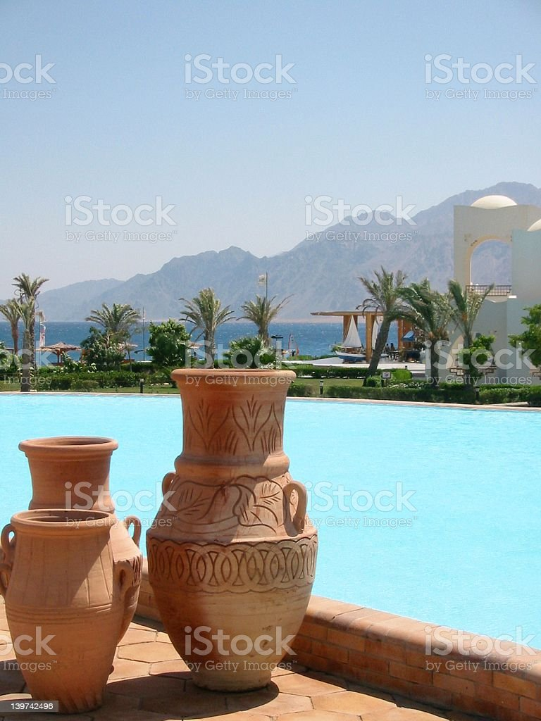 Arabic Urns in front of water and mountains stock photo