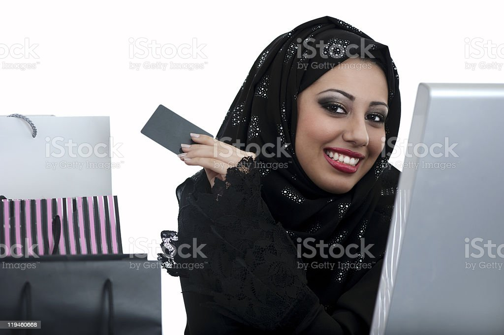 Arabic Woman Shopping online, with Credit Card. royalty-free stock photo