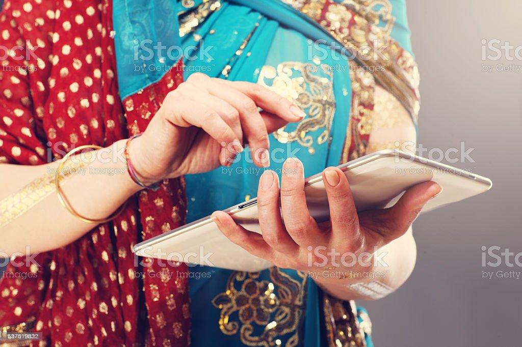 Arabic woman using tablet stock photo