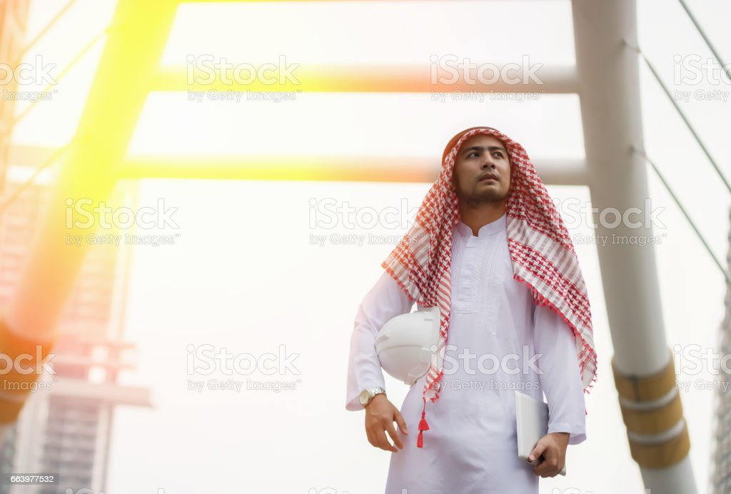 Arabic young architect engineer at working place stock photo