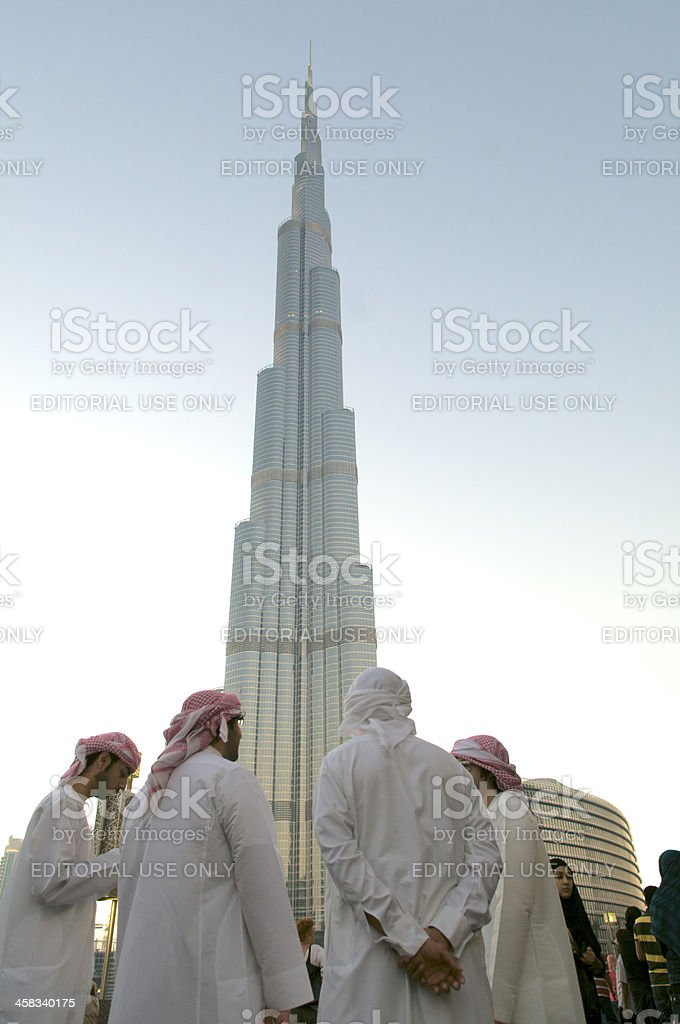 Arabs below the Burj Khalifa royalty-free stock photo