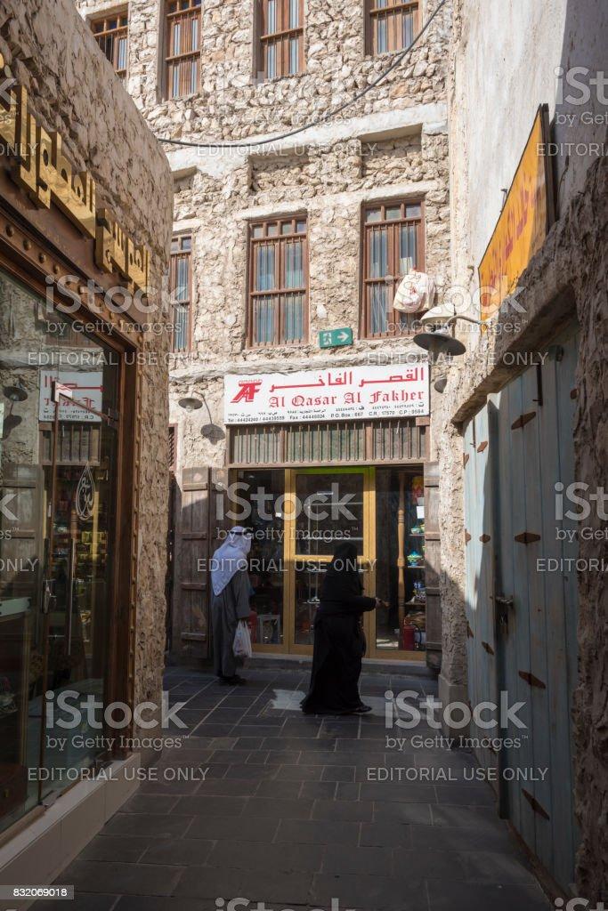 Arabs shopping in Souq Waqif in Doha, Qatar stock photo