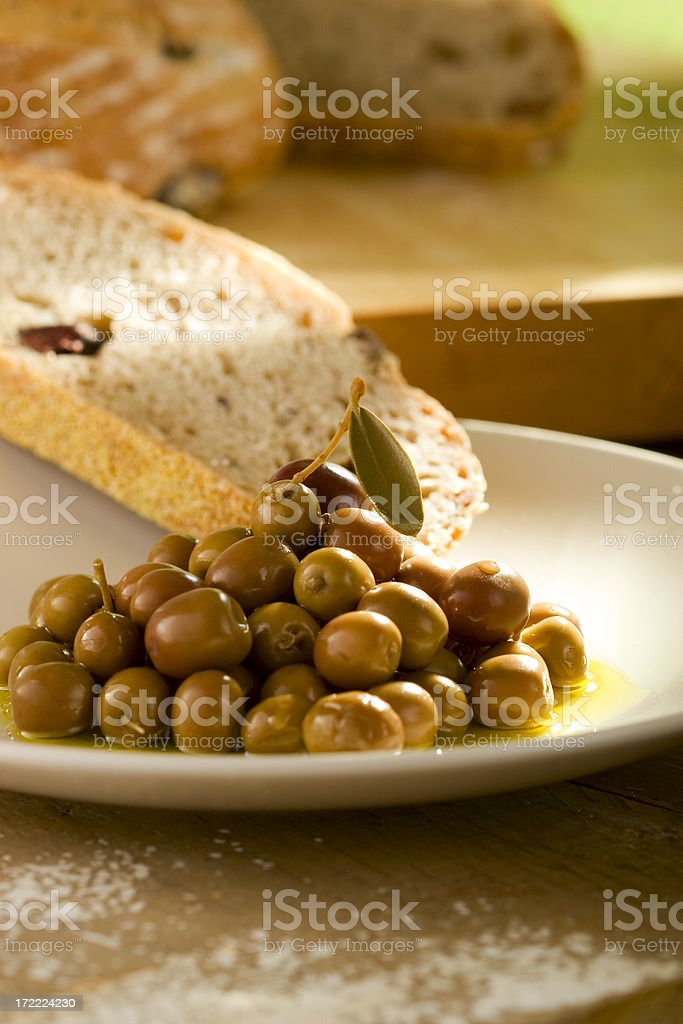 Arbequina olives with olive bread stock photo